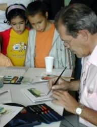 Juan Carmaniu creando una obra ante la vista de los asistentes